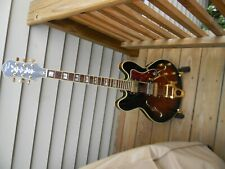 epiphone by gibson 335 guitar with bigsby vibrado