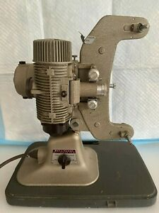 Vintage 8 mm Bell and Howell movie projector with original cord and new bulb