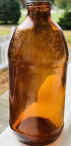 Vintage 1976 Stroh's  Amber Beer Bottle Embossed Lion Crest No Deposit