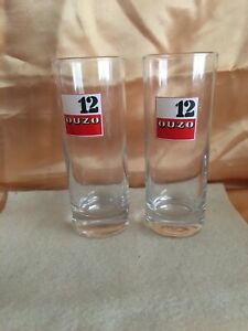 """SET OF 2  """"12 OUZO"""" UNUSUAL TALL  ADVERTISING DRINKING GLASSES"""