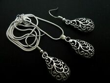A TIBETAN SILVER TEARDROP THEMED NECKLACE AND EARRING SET. NEW.