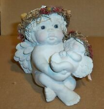 "Dreamsicle Figurine, ""Hushaby Baby""  1995"