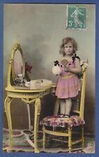 Little Blonde girl doing make-up at the miror vintage photo postcard