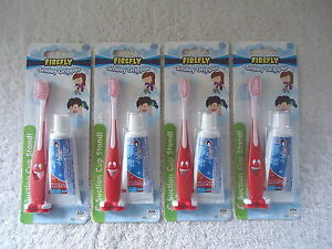 """Lot Of 4 """" NIP """" Kids Firefly Smiley Gripper Soft Toothbrush & Kids Crest Toothp"""