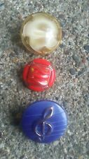 Vintage Moonglow, Red, and Musical glass buttons.