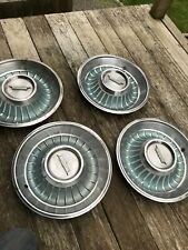 VINTAGE 1961 1962 ? CADILLAC  HUBCAPS WHEEL COVERS light green set of 4