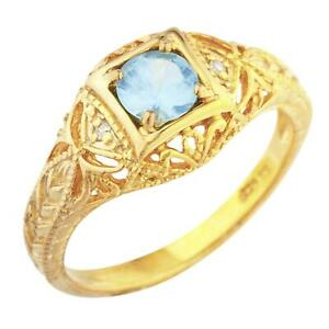 14Kt Gold Blue Topaz & Diamond Round Design Ring