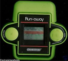 80s GRANDSTAND RUN AWAY ELECTRONIC HANDHELD LCD GAME VINTAGE 1980S ARCADE TOY