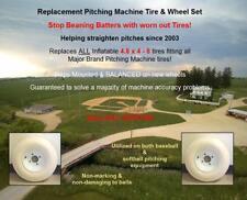 Two Universal pitching machine tires mounted on balanced wheels