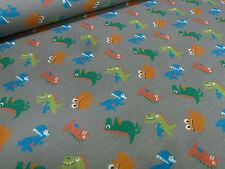 ☻ Stoff Baumwolle Jersey Monster Dinos Kinderstoff taupé bunt ☻