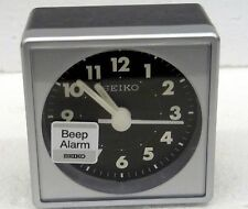 SEIKO -  MINI  SQUARE AND BLACK FACE WITH QUIET SWEEP BEEP ALARM CLOCK QHE083SLH
