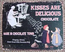 """A REPRODUCTION OF AN ANTIQUE METAL SIGN  """" KISSES ARE DELICIOUS CHOCOLATE """""""