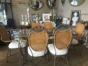 DINING TABLE setting 6 chairs glass top with cane and iron legs and details