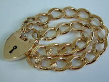 SOLID 9CT YELLOW GOLD PATTERNED CHARM BRACELET WITH PADLOCK - 8.5 INCHES