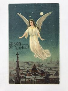 Antique 1907 Christmas Postcard Embossed Angel Flying Over Town