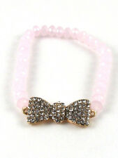 Gold Toned Clear Rhinestone Bow Stretch Bracelet With Light Pink Crystal Beads