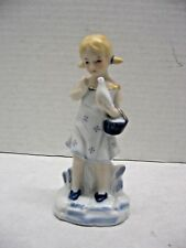 Vintage Girl and Dove Figurine Blue and White Porcelain Gold Accents