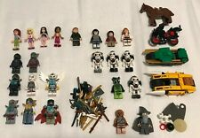 Lego Minifigure Lot of 23, 40 weapons, (Chima, Lord of the Rings, Ninjago, ETC.)