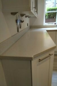 Corian Work Surfaces with Sink Cut-Out and Corian Island with Cut-Out for Hob