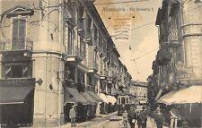 8912) ALESSANDRIA VIA UMBERTO AFFOLLATA BAR NAZIONALE E TRAM STAZIONE VG 1915.