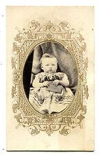 CIVIL WAR ERA CDV. BABY HOLDING BOOK. STRONG IMAGE.TAX STAMP.