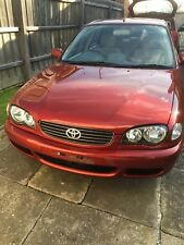 Toyota Corolla ae112 Red Wrecking Car For Parts Suit 1998 1999 2000 2001 Models.