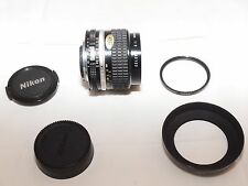 Nikon NIKKOR  24mm f/2 AIs FAST wide angle lens. Nikon hood & filter. Nikon F3