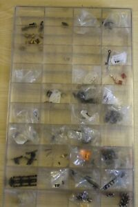 MINITRIX ASSORTED SPARES INCLUDING COUPLINGS WHEELS  & AXELS & GEAR WHEELS