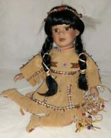 Porcelain Native American Indian Doll sitting 11 inches tall with Dream Catcher