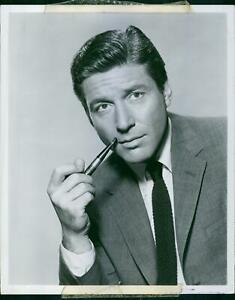 Close up of American actor Efrem Zimbalist Jr have looked towards the camera a