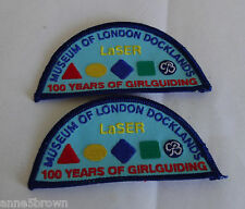 2010 GIRLGUIDING CENTENARY MINT LASER MUSEUM OF LONDON DOCKLANDS BADGE/PATCH x 2