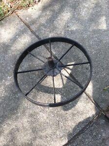 Antique metal wheelbarrow wheel