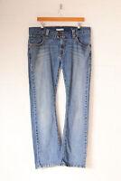 Vintage Levi's 542 Flared Jeans Mid Blue (W36 L32)