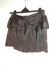 Black mini skirt with bow design by Flowers size 10/12