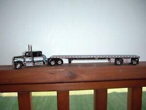 DCP FIRST GEAR 1/64 BLACK & WHITE KENWORTH W900 WITH SLEEPER & FLAT BED TRAILER