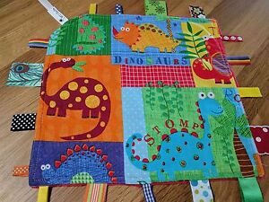 Taggie Blanket bright dinos with red dimple minky backing