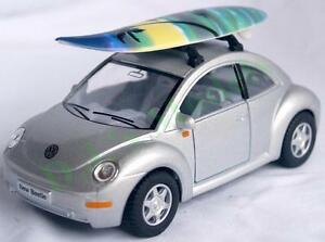 Diecast 1:32 V.W. Volkswagen new beetle with surf board in silver