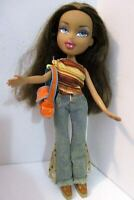 Bratz doll long dark brown hair she has top jeans tan boots & orange bag.