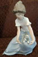 NAO BY LLADRO DAISA 1986 GIRL SEATED WITH PUPPY ON LEFT KNEE EXCELLENT COND.