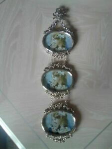 Antique silver tone oval hanging photo frames