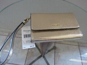 Nine West NWT $40 metallic gold leather Wristlet Wallet Phone Case