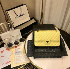 The brand new Chanel Yellow  Bag Classic Double Flap Jumbo Caviar