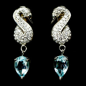 SKY BLUE TOPAZ ART DECO SWAN EARRINGS WITH WHITE CZ .ACCENTS 925 STERLING SILVER