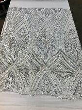 SILVER SEQUIN DIAMOND DESIGN EMBROIDERY ON A 4 WAY STRETCH WHITE MESH-SOLD YARD.