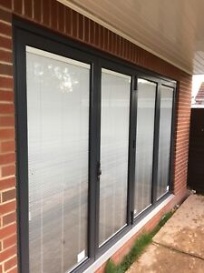 Bifold, Sliding Warmcore Doors, installation by experts