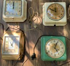 Lot of 4 vintage wall clocks mid century
