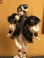 Black and gold harlequin porcelain doll