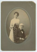 Elderly Gentleman on Carved Chair with Newspaper and Daughter Antique Photograph