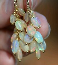 Pair oval 5ct Ethiopian fire Opal solid gold 14k dangle cluster earrings