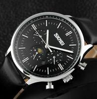 SKM Analog Herren Armband Uhr Schwarz Silber Farben Datum Tag Nacht - Anzeige
